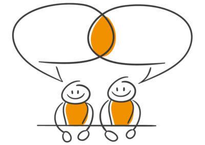 2 Strichmännchen mit Sprechblasen zum Thema Sprache